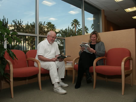 Smiling patients reading magazines in waiting room